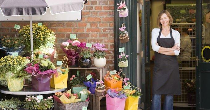 woman standing in store doorway
